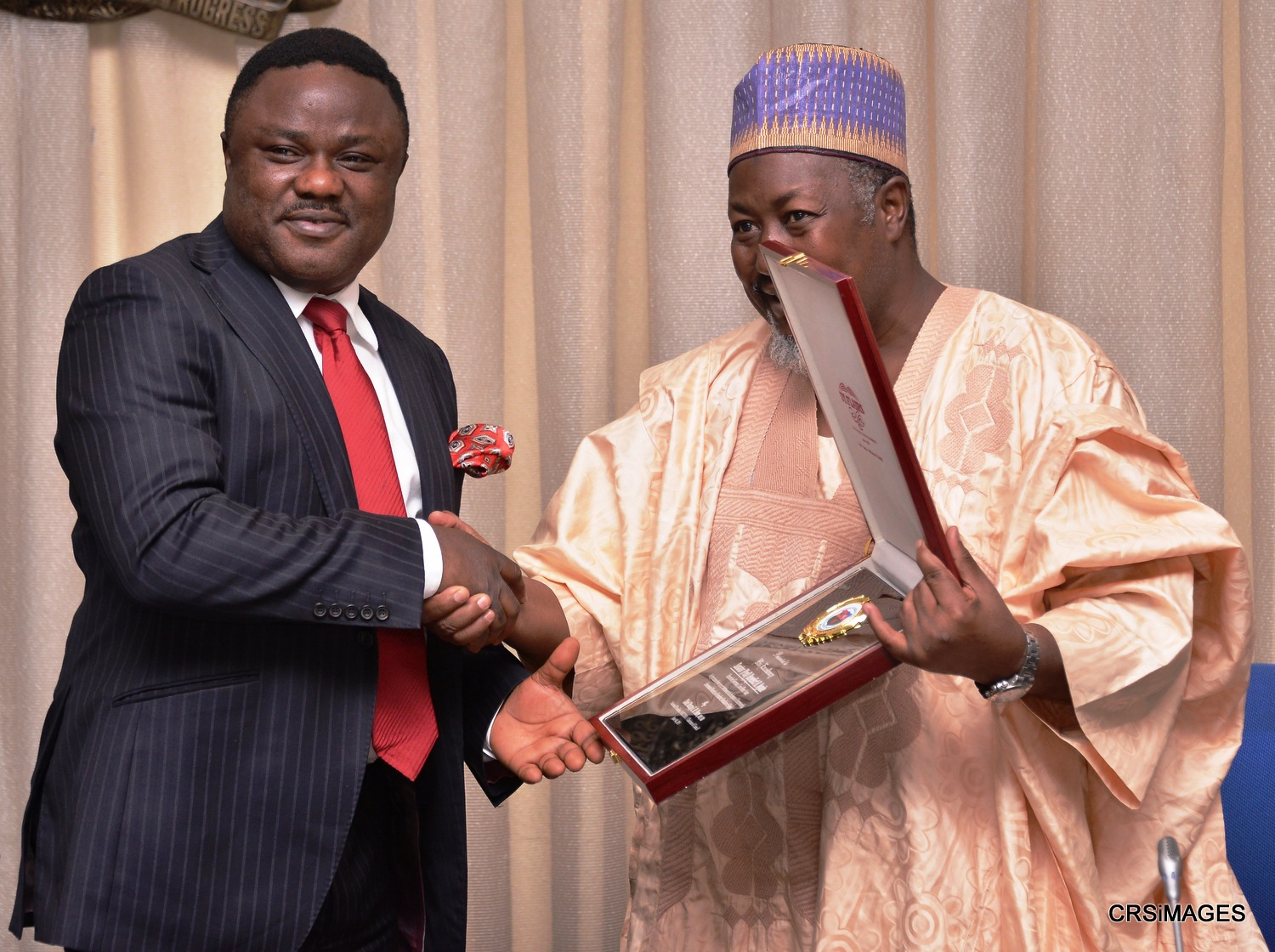 Cross River State Governor, Senator Ben Ayade being presented with a plague by Alhaji Muhammed B. Abubakar, Governor of Jigawa State and immediate past National President of Nigerian Association of Chambers of Commerce, Industry, Mines and Agriculture (NACCIMA) during a courtesy call in Government House Calabar, today