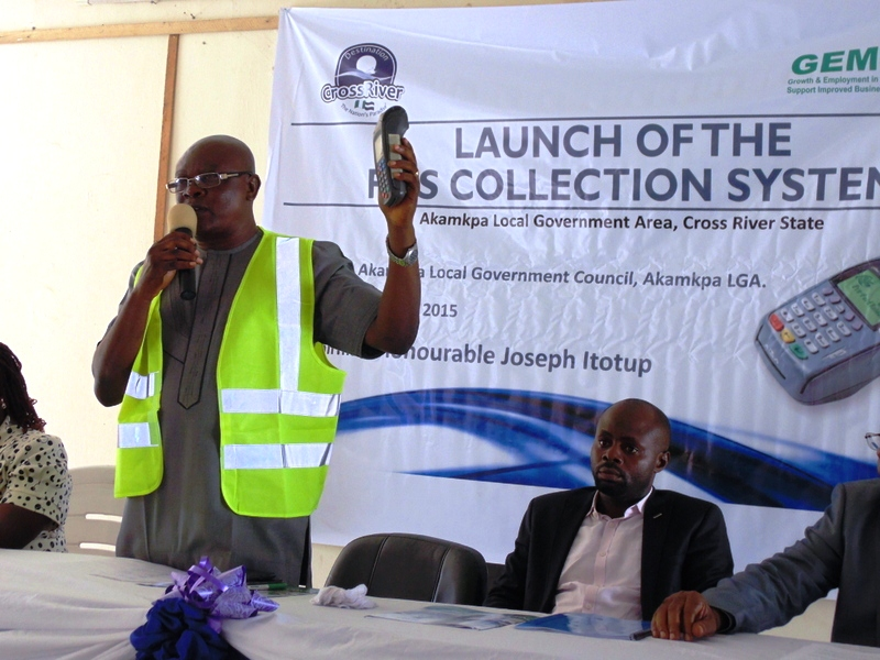 The Chairman of Akamkpa LGA, Hon. Joseph Itotup officially launches the POS collection system.