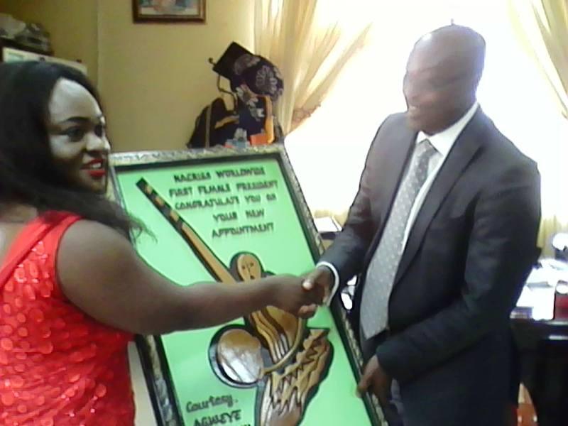 Philomina Agweye presenting a gift to Professor Zana Akpagu