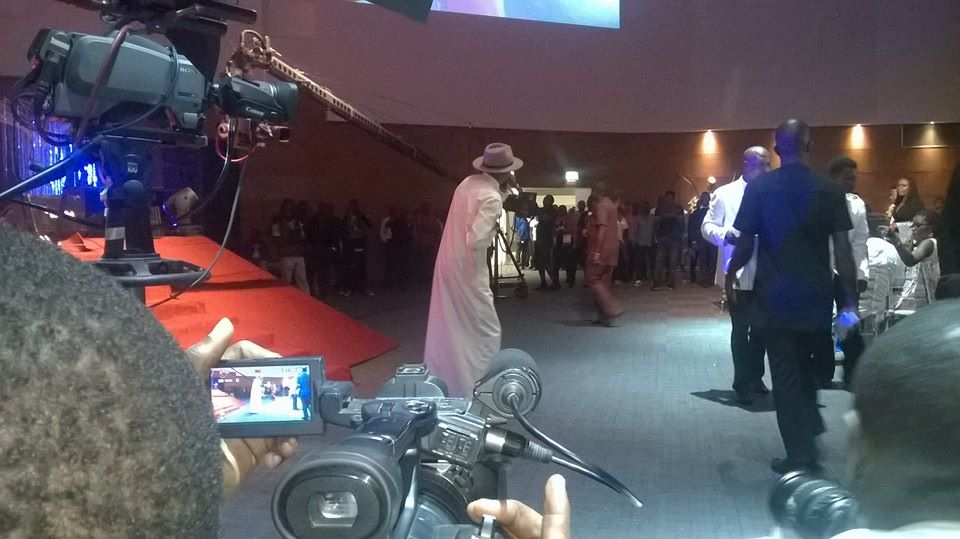 Tuface Idibia performing at the inaugural ball at the CICC while the governor watches from a distance