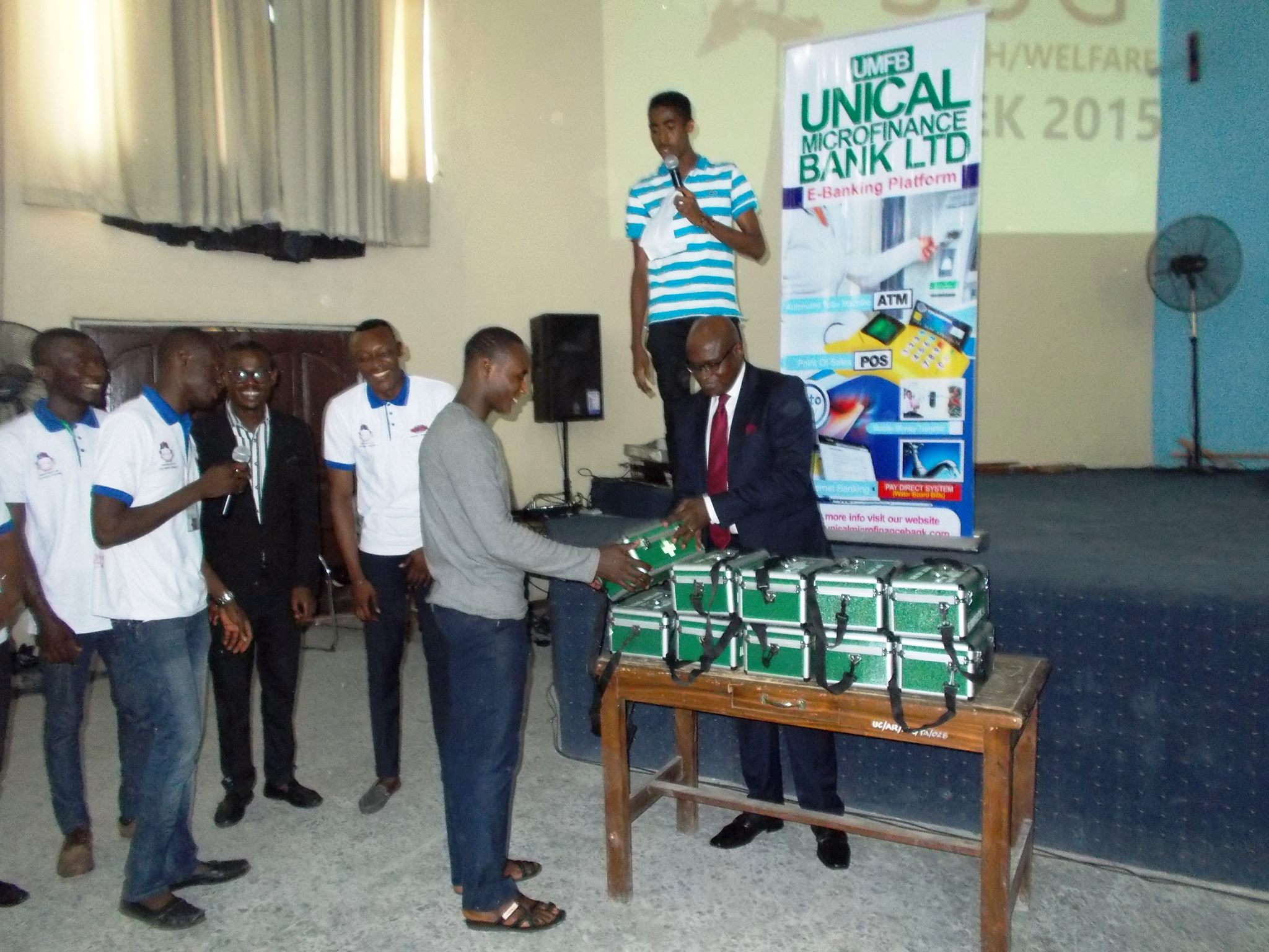 Manager, UNICAL Micro Finance Bank displaying first aid boxes to SUG officials at the event