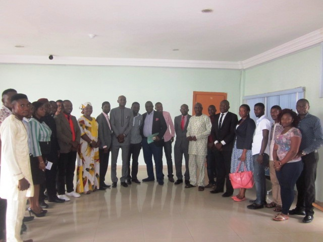 Speaker in a group photograph with NACRISS Executives
