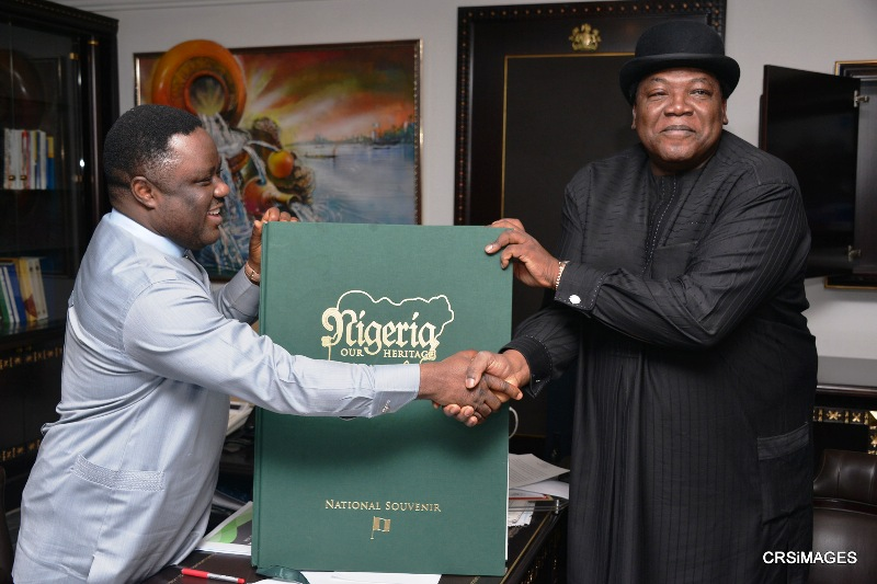 Governor Ayade of Cross River State in a handshake with former Tourism, Culture and National Orientation Minister, Edem Duke after the book presentation in Calabar