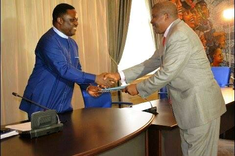 Cross River State Governor Benedict Ayade in a handshake with the chairman Cross River State Security Taskforce, Operation Skolombo, Brig Gen Mannix Nyiam (rtd) today after the inauguration of the taskforce in Calabar