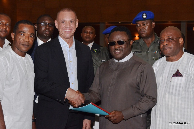 Guy Murray Bruce and Governor Ben Ayade exchanging contract documents