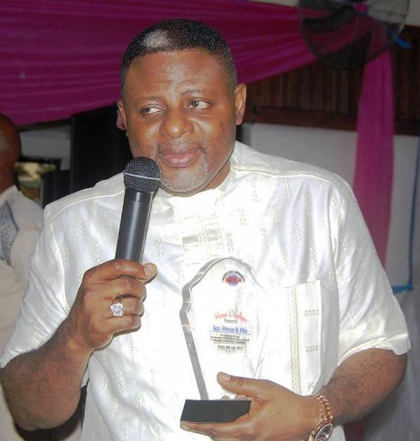 Senator Bassey Otu bearing his award