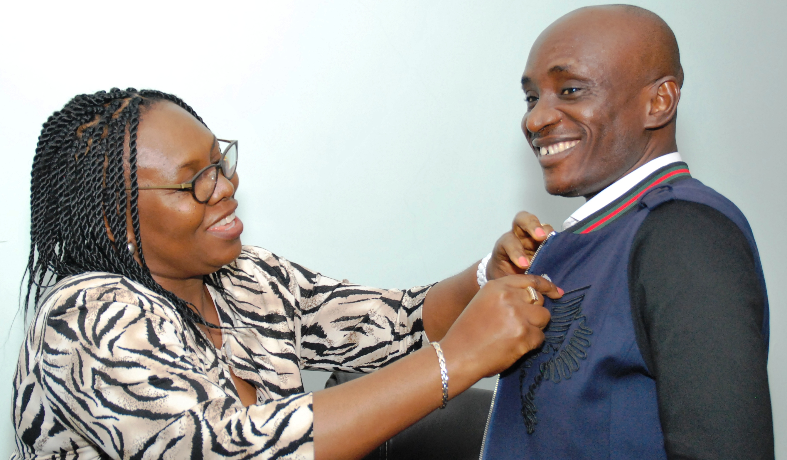 The investiture and decoration of the Speaker, Hon. John Gaul, as honorary member of the Calabar Chamber of Commerce, Industry, Mines and Agriculture by the President, Mrs. Thelma Kayode Bello.