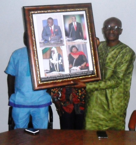 Speaker, Hon John Gaul displaying the frame presented to him by members of the CRUTECH alumni association who paid him a courtesy call