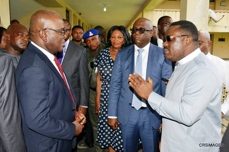 Cross River State Governor, Senator Ben Ayade directing the Acting Head of Service of the state, Mr. Ekpenyong Henshaw, (L), to take disciplinary action on Directors who were absent during an unscheduled visit by the Governor, to selected Ministries in the State. Calabar