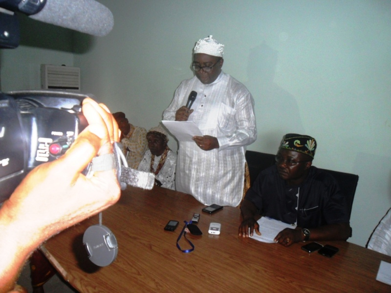 The chairman of the Ikang Combined Assembly speaking while Hon. Ekpo (right) and others watch