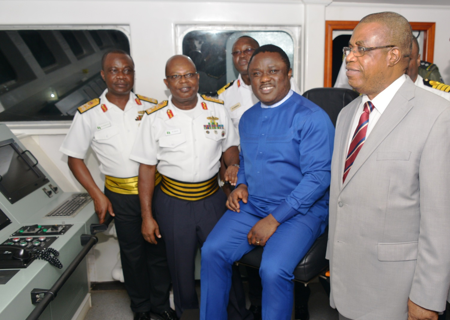 Governor Ayade on board NNS Centenery along with the CNS to his right and the deputy governor to his right