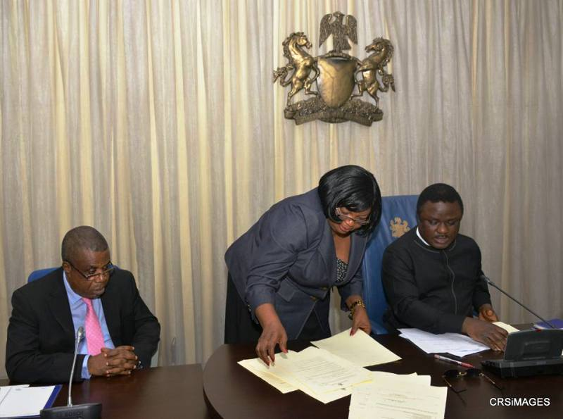 Governor Ben Ayade sorting out the bills with the Secretary to State Government, Mrs. Tina Agbor while Deputy Governor, Ivara Esu looks on earlier today in Calabar