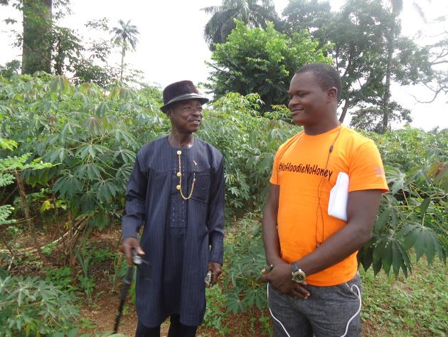 Ibrahim Olalekan with the Farm Supervisor at St Joseph's School Farm.
