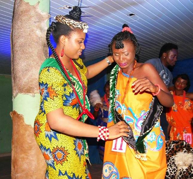 Out-gone Queen Evelyn Ugbaka, decorating the new Face of Obudu Culture, FOC Queen Retina Ashibekong