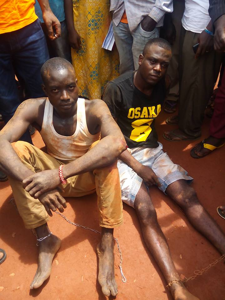 Two of the suspected robbers arrested with locally made pistols in Obudu
