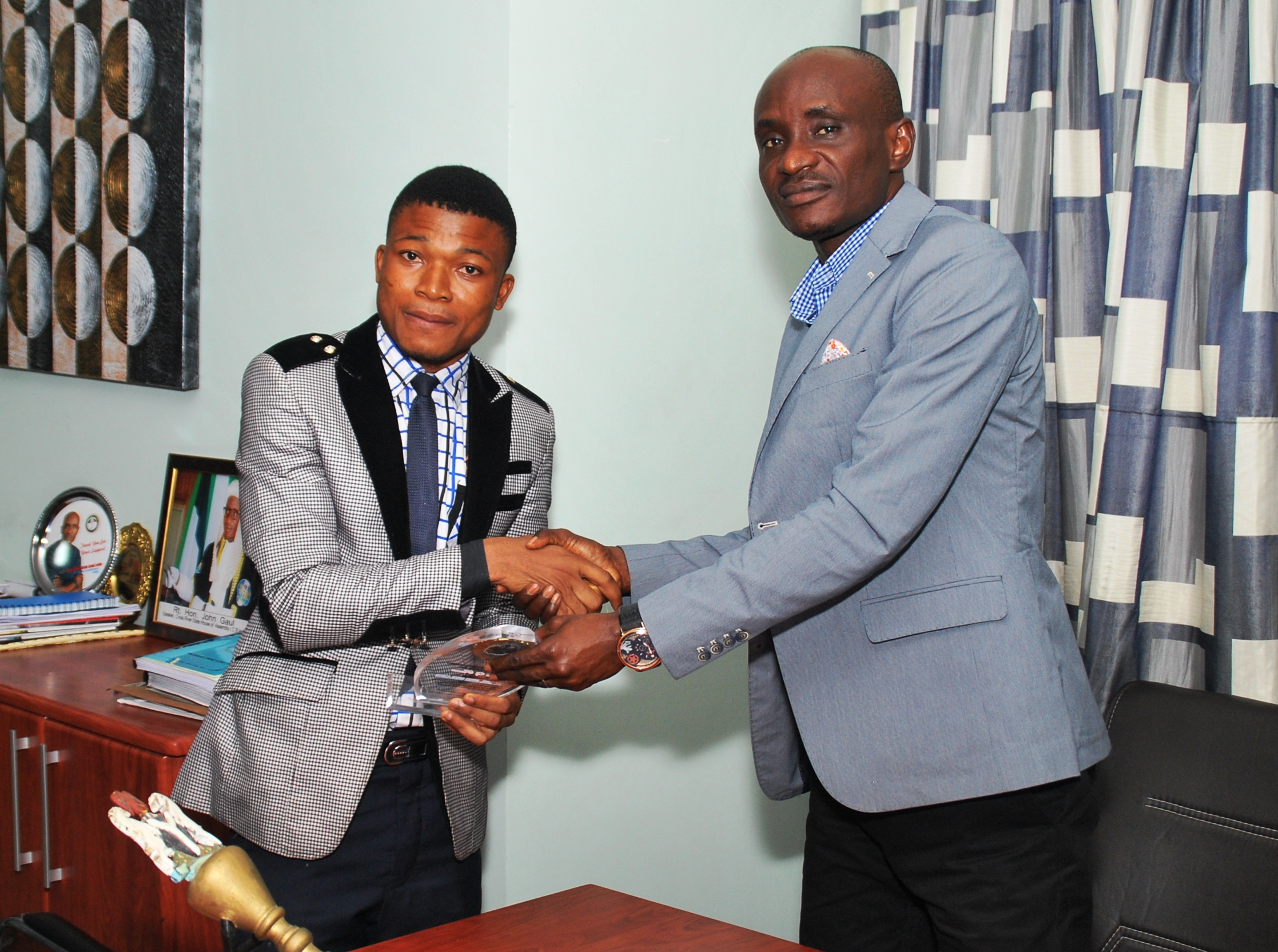 Speaker, CRSHA recieving an award of excellence from the president of the central students association