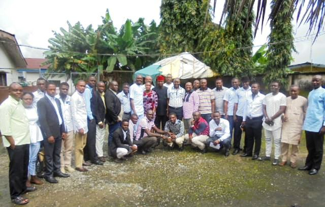Attendees in a group photograph after the meeting
