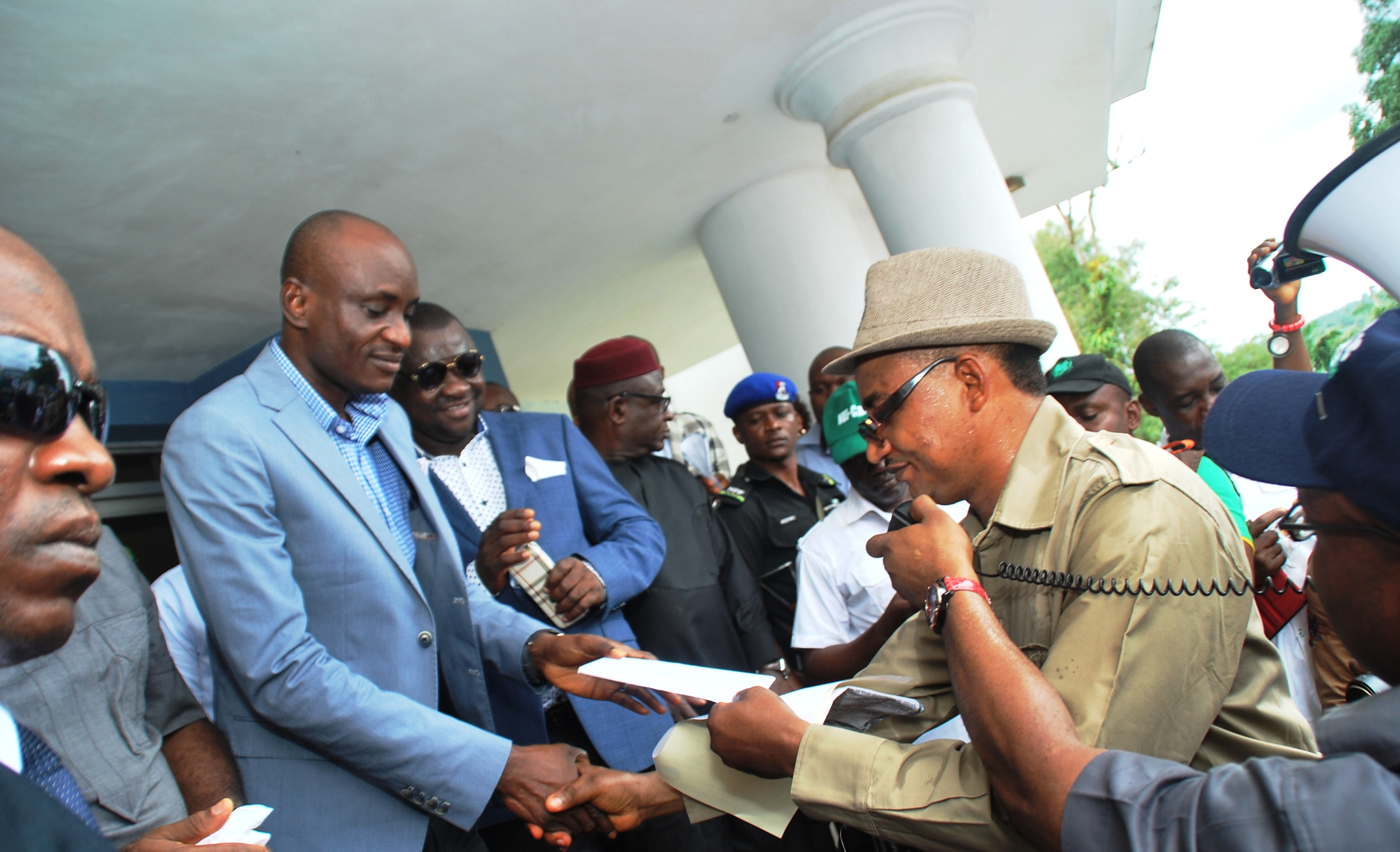 Speaker John Gaul (left) receiving a letter from the State Chairman of NLC, Comrade John Ushie (right) when Labor led a protest recently to the Assembly to call for an end to corruption in Nigeria (file pix)