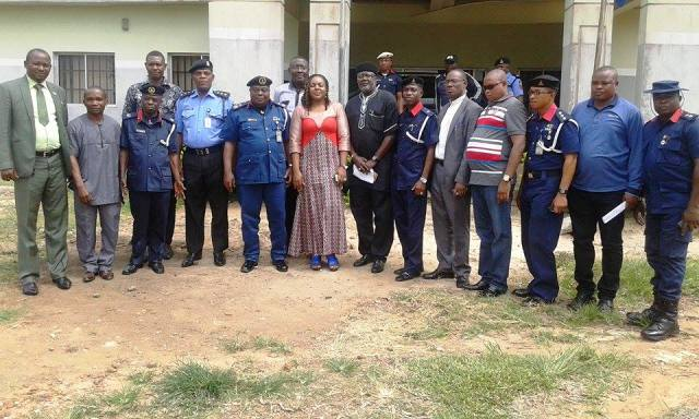 The Abi LG Chairman, Hon. Edith Amadi, (middle) the state commandant of Civil Defence Corps and others stakeholders in a group photograph after the peace meeting