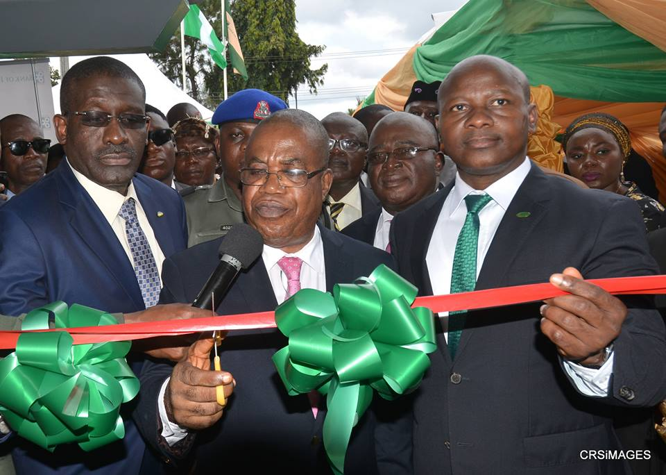 Deputy Governor of Cross River State, Professor Ivara Esu cutting the tape to commission the Bank of Industry in Calabar