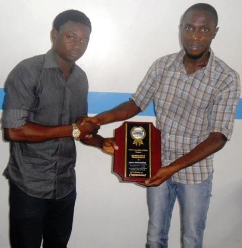 MD Mountain Cinema, Frank Akpeke, presenting the award to Mr. Archibong Jeremiah