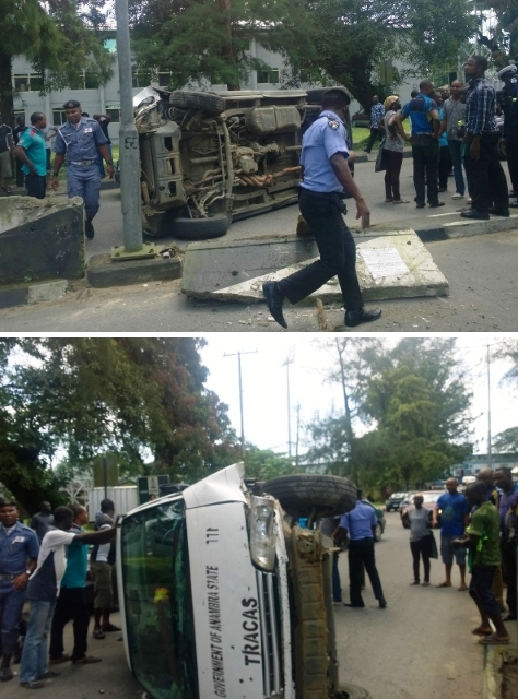 scene of the lone accident with policemen and other sympathizers helping to get the vehicle out of the road