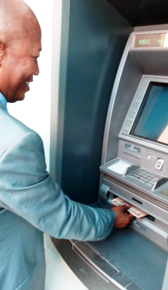 Hon. Abubakar Ewa, Chairman, Boki LGA become the first person to use an ATM Machine on Boki soil