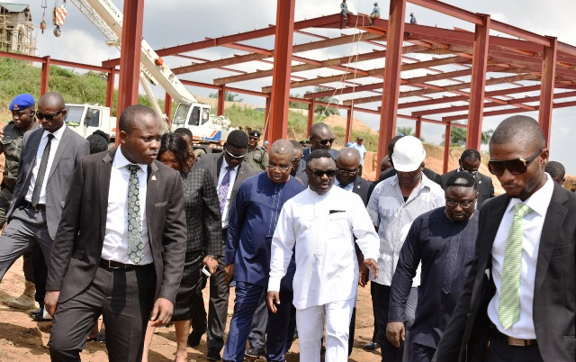 Governor Ben Ayade (middle) flanked by his Deputy, Professor Ivara Esu and the Governor's brother, Dr. Frank Ayade, after the governor inspected the level work at the garment factory in Calabar