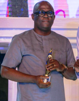 Mr. Christian Ita, Chief Press Secretary to Governor Ayade receiving the award for the governor in Lagos