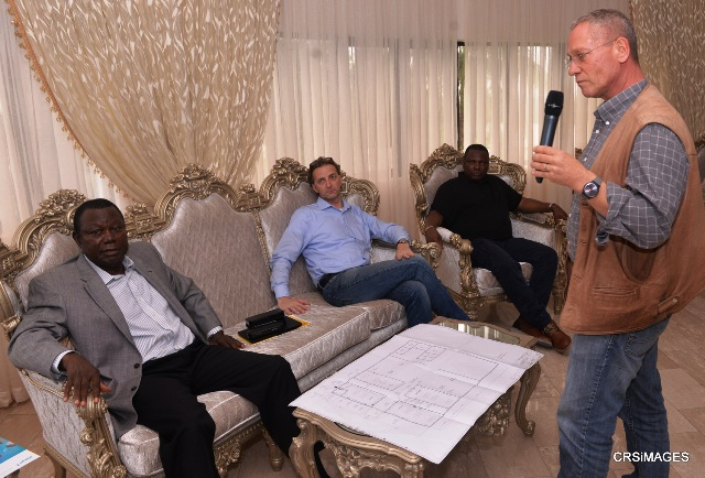 Lead German Quality control expert, Mr.Gunther Honisch taking the Chairman, InfraCross Ltd, Chief Eugene Akeh and other expatriates through the architectural design of the proposed Cross River Quality Control Laboratory to aid the superhighway