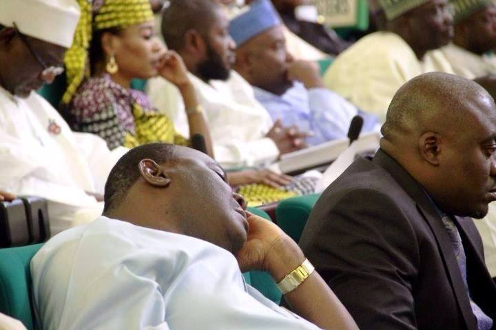 Hon. Essien Ayi sleeping at the budget presentation today while Hon. Legor Idagbo pays attention