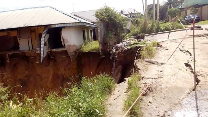 A home threatened by the ravin with speculations it must have been washed away