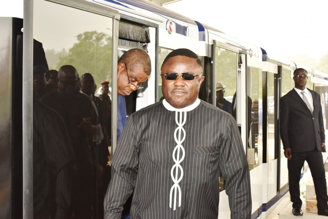 Cross River State Governor, Senator Ben Ayade and his Deputy Prof. Ivara Esu both alighting from the newly installed Calabar monorail coach shortly after the contractor test ran the facility in Calabar