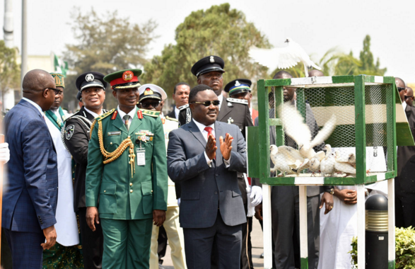 """Cross River State Governor, Senator Ben Ayade, applauding the """"freedom flight"""" of white pigeons he released, to symbolize peace shortly after laying the remembrance wreath at the Cenotaph to bring the 2016 Armed Forces Remembrance Week to a close in Calabar yesterday"""