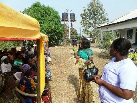 Dr. Betta Edu, SA Community Health, addressing a crowd of women who attended the free medical outreach at Adadama village, Abi LGA