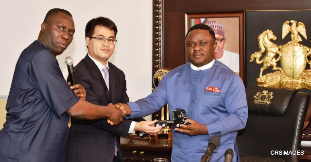 Cross River State Governor, Senator Ben Ayade (Right), being presented with a miniature version of Sino truck by Head of African Division, Sino Trucks of China, Mr. John Wang (Middle), and the Managing Director, Nigeria Sino Trucks, Mr. Alfred Okugbeni, during an investment meeting at the Governor's office, Calabar