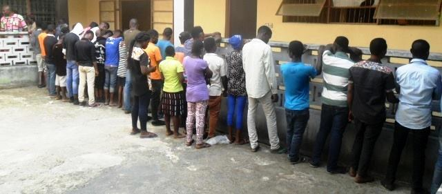 The suspected traffickers and victims at the Immigration Office in Abi