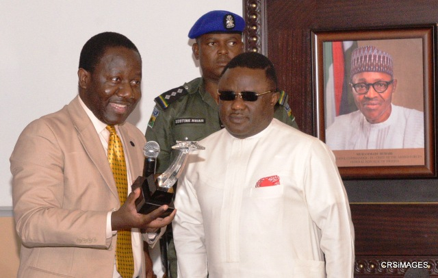 Executive Director Center for Peace and President/CEO of US-UNESCO Clubs, Centers and Associations, Mr. Guy Djoken presenting 2016 Award of Excellence to the Governor of Cross River State, Senator Ben Ayade when a delegation from the organization visited Government House, Calabar, weekend