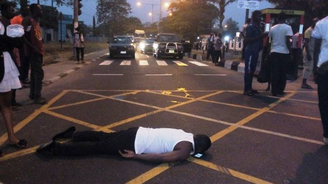 One of the physically challenged protester lying on the road