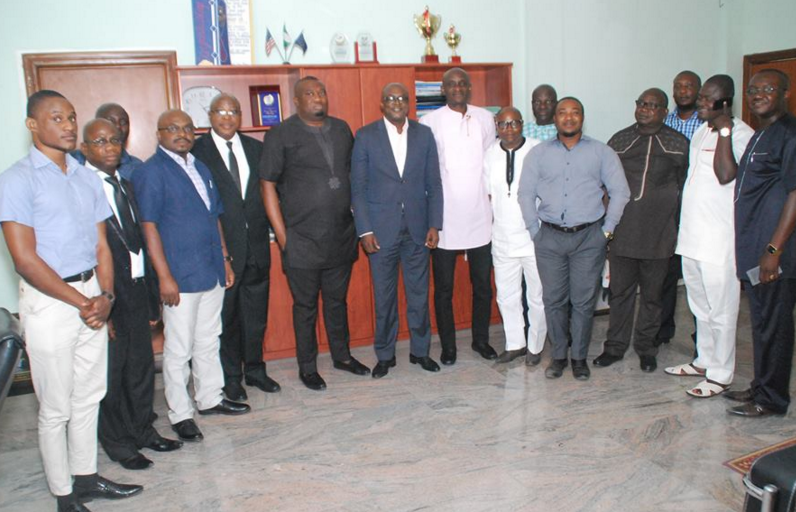 Cross section of the visiting delegation from Hit FM and the Speaker of CRSHA, Hon. John Gaul (middle) and some members of the House in a group photograph after the visit