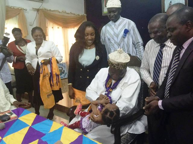 The DG of Cross River State Primary Health Care Development Agency, Dr. Betta Edu watching as the Obong of Calabar immunizes a baby in his palace during the visit of the DG to the Monarch