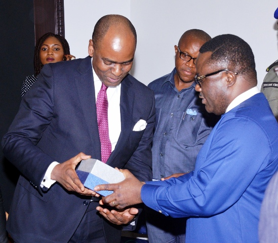 Cross River State Governor, Senator Ben Ayade presenting a souvenir to the Chairman, Lafarge Africa, Mr. Bolaji Balogun when the latter led a team of his management staff on a courtesy visit to Government House, Calabar, yesterday