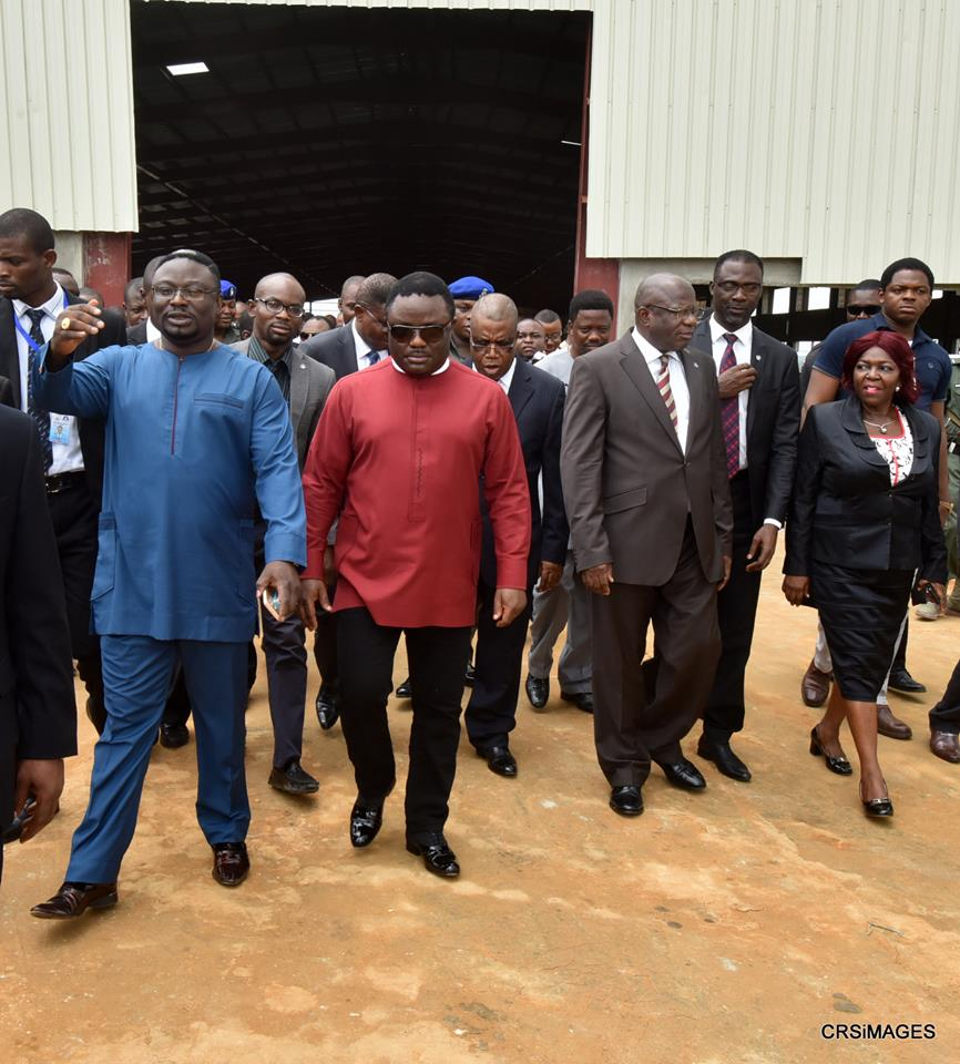 Governor Ben Ayade (in red shirt) flanked by his younger brother, Dr. Frank Ayade (in blue) on project inspection of the Garment Factory (file picture)
