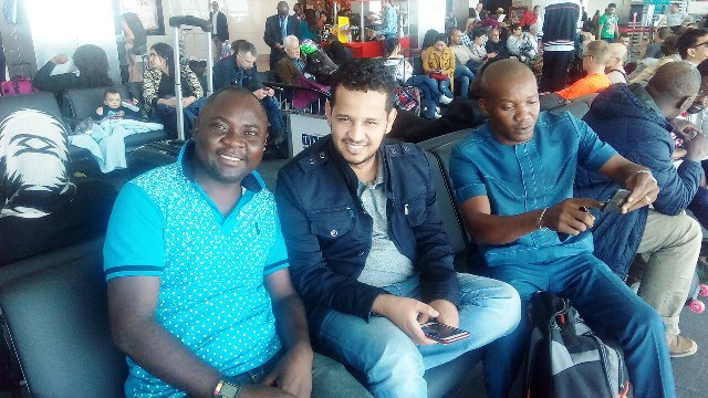 Declan Ogar, an unidentified passenger and Ndiyo at the Departure Hall of the Murtala Mohammed International Airport on their way to the World Youth Summit in Colombo