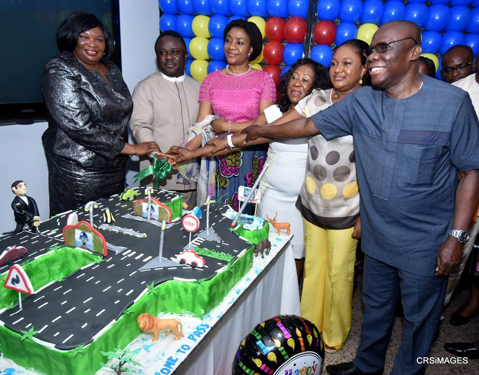 Governor Ben Ayade (second from left), his wife Linda Ayade, the Secretary to the State Government, Barrister Tina Agbor (first from left) the State Chairman of PDP, Ntufam John Okon (first from right) and his wife during the belated cerebration of the governor's birthday in his conference room in Calabar. The birthday cake depicts the superhighway and the reserved forest and animals
