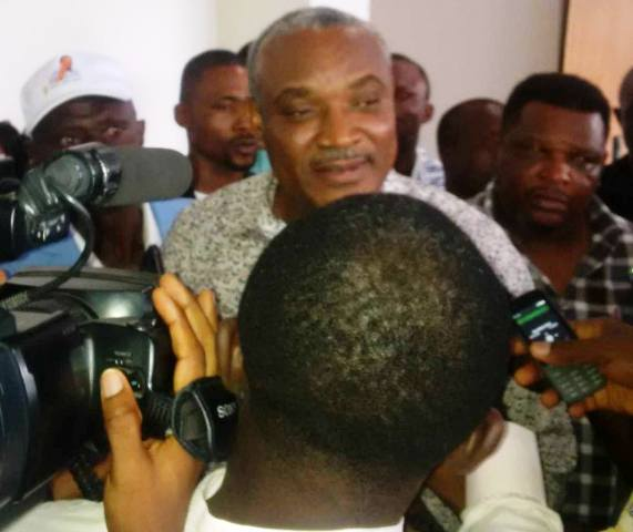 Special Assistant to President Buhari on Prosecution, Chief Okoi Obono Obla talking to journalists on arrival at the Margaret Ekpo International airport in Calabar