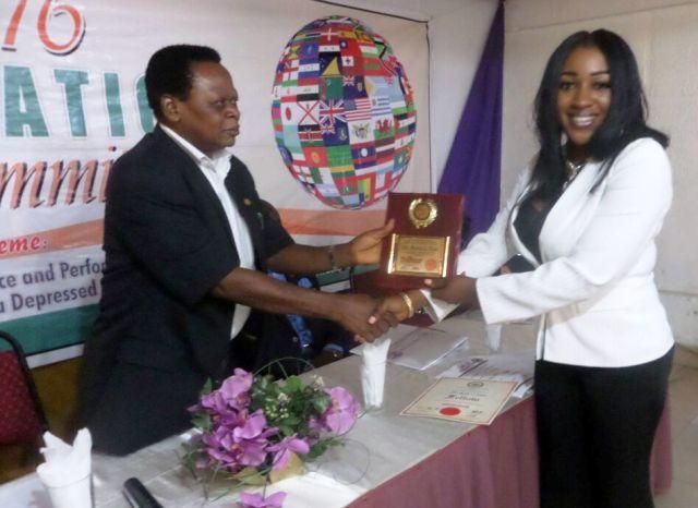 Dr. Betta Edu receiving the award in Calabar