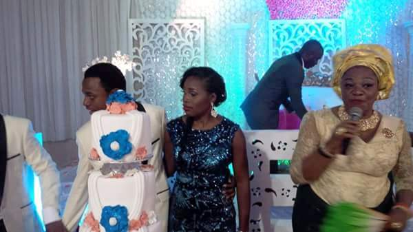 Former Spokesperson of the Department of State Security DSS, Ms. Marilyn Ogar, (R) cutting the cake with Nelly Abi and Obiom Enagu Ogar after the couple got wedded yesterday in Abuja