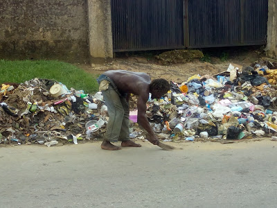 Mad man sweeping Calabar