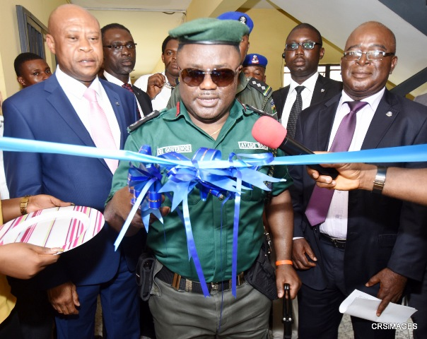 Cross River State Governor, Senator Ben Ayade (M) flanked by Head of Service of the state, Ekpenyong Henshaw (R) and the Attorney General and Commissioner for Justice, Joseph Abang cutting tape to commission the Ministry's E-library in Calabar